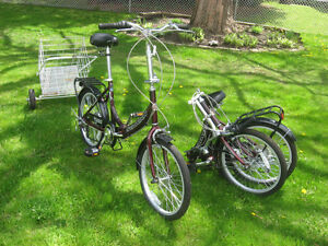 two folding bikes and one mountain bike