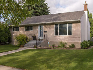 DON'T MISS THIS RIVER HEIGHTS BEAUTY!