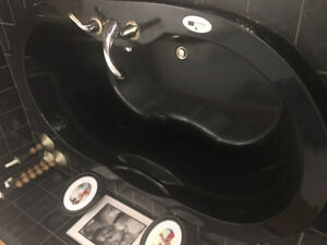 Jacuzzi tub with heater