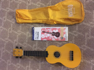 Ukulele with Case and Beginners Book.