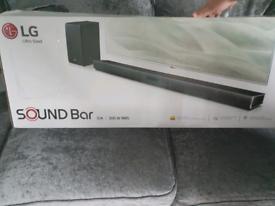 LG sound bar SJ4 and wireless subwoofer