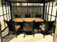 Slate top table and 7 chairs and 7 pillows
