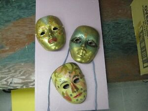 Solid brass theatrical masks.