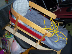 Wooden baby sleigh, with pad,baby fits inside, cosy and warm