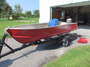 Boat and trailer with 9.9 Evinrude motor