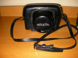 Vintage Minolta Autopak 700 /Lense/Original Leather case