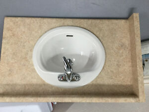 Bathroom countertop with sink and taps