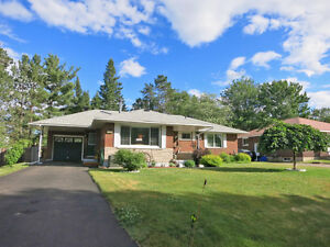 BEAUTIFUL BRICK BUNGALOW WITH ABOVE GROUND POOL  ID# 1046993