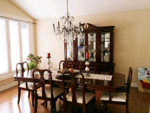 Solid wood dinning table plus buffet hutch.