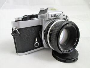 NIKON FE avec 50mm 1.8 et cap. Ajusté nettoyé et testé.