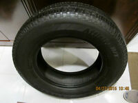Firestone 215-70-16  70% of tread left