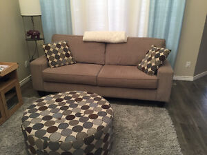 Grey couches with ottoman