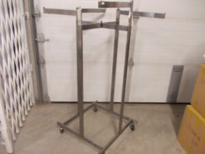 USED Four (4) way clothing rack with Casters