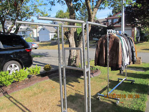 rolling clothes rack  in excellent condition  adjustable
