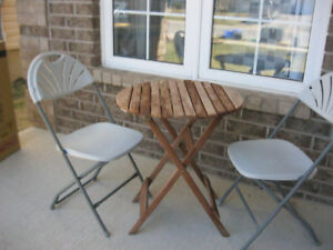 like new folding table and 2 chairs for sale