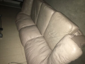 Cream coloured leather couch and love seat