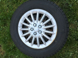 4 winter tires (ice guard) 215/65R16 on rims with hubcaps