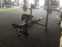 Multi purpose weight bench with 125kg of weights