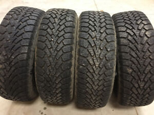 Almost new 195/60/15 Goodyear Nordic snow tires on GM 4 bolt rim