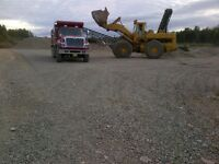 "crushed 2"" stone or 3/4"" gravel by the tandem load"