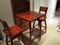 Classical Indonesian teak wood bar table and 2 swivel chairs