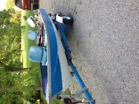 selling 14 ft aluminum boat 9.9 johnson