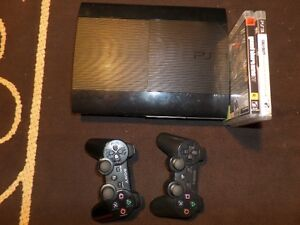 Ps3 super slim for sale with 2 games. MW3 AND GTA 4!!