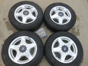 P215/65R16 Hankook iPike RC01 Winter Tires on Windstar Alloys
