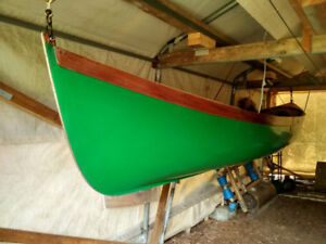 Double ended slide seat wooden rowboat