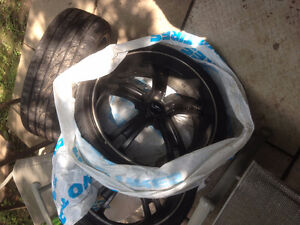 Set of Black 20' Rims And Tires
