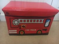 Fire truck toy storage box with lid.