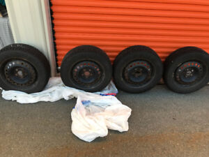 """Four 16"""" Toyo Winter Tires with Steel Rims"""