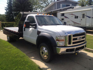 2009 ford f 550 xlt 4X4 6.4L diesel Auto loaded with 11ft dump b