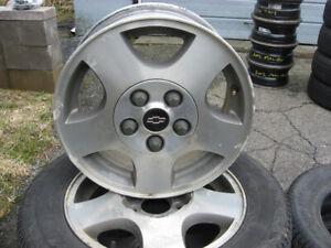 4 aluminum rims and 4 tires 215/60/15