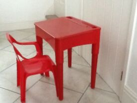 CHILDS RED PLASTIC DESK WITH STORAGE