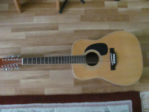 FOR SALE NICE 12 STRING ACOUSTIC GUITAR.