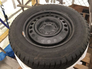 Set of 4 Winter tires on rims. Size - 225/60R16. New last year.