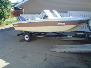 Sea-Sport 16 foot trihull with 60 HP Evinrude and Calkis trailer