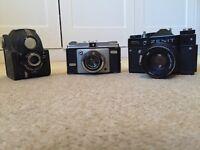 Three vintage retro old cameras