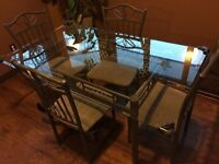 Glass top dining set with 4 chairs