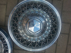 Older Chrysler hubcaps