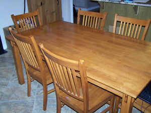 Solid Wooden Table with Six Chairs.