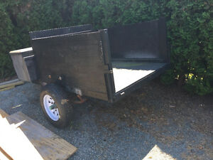 Small new utility trailer with lock box
