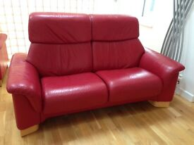 Ekornes Stressless cherry red leather reclining two seater sofa