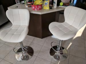 2 white gas bar stools