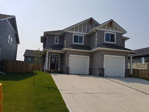 BRAND NEW 3 bdrm,master ensuite,garage steps to Duncan Cran scl