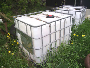 2 1000 litre poly tanks with cages.