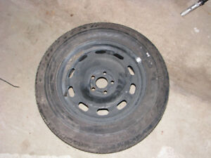 Volkswagen stock 5x100 15 inch rim with newt tire 195-65-15