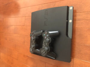 PlayStation 3 with 2 Controllers & 4 games