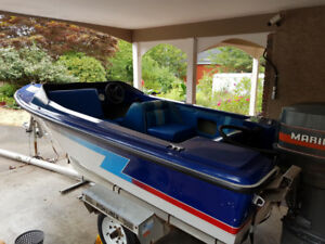 15' speed boat with trailer and 90 horse motor.